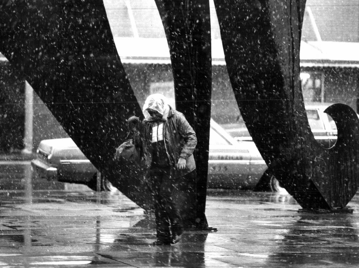 Snow falls in Detroit at the Calder statue at Cass at Michigan in 1981.