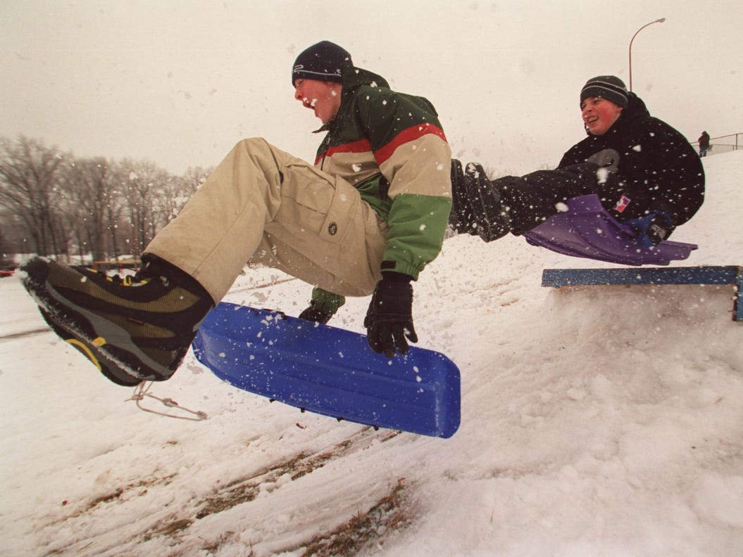 14-year-old Jeremy Baker, of Ferndale, left , and 13 year-old Shane Burr, of Ferndale, go airborne after targeting a homemade jump with their sleds at Martin Road Park in 2002.