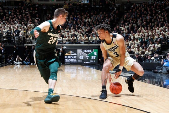 Purdue's Carsen Edwards dribbles as Michigan State's Matt McQuaid defends Jan. 27.