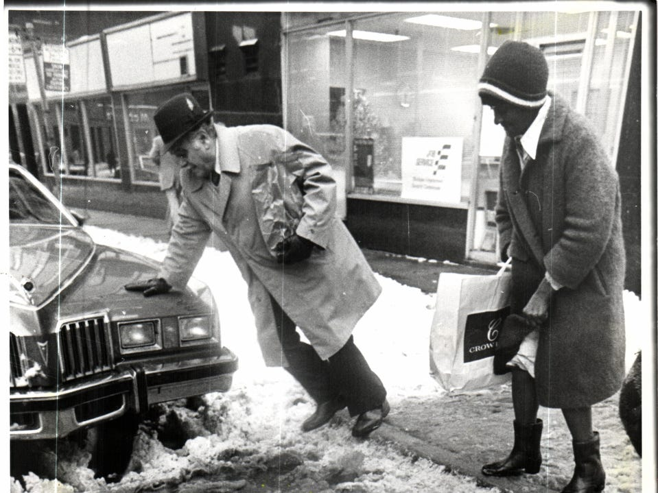 As temperatures registered in the mid-30s, snow turned to slush, causing scenes like these throughout Detroit in 1977.