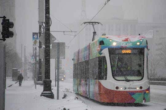 The Qline heads north on Woodward as heavy snows hit metro Detroit on Monday, Jan. 28, 2019.