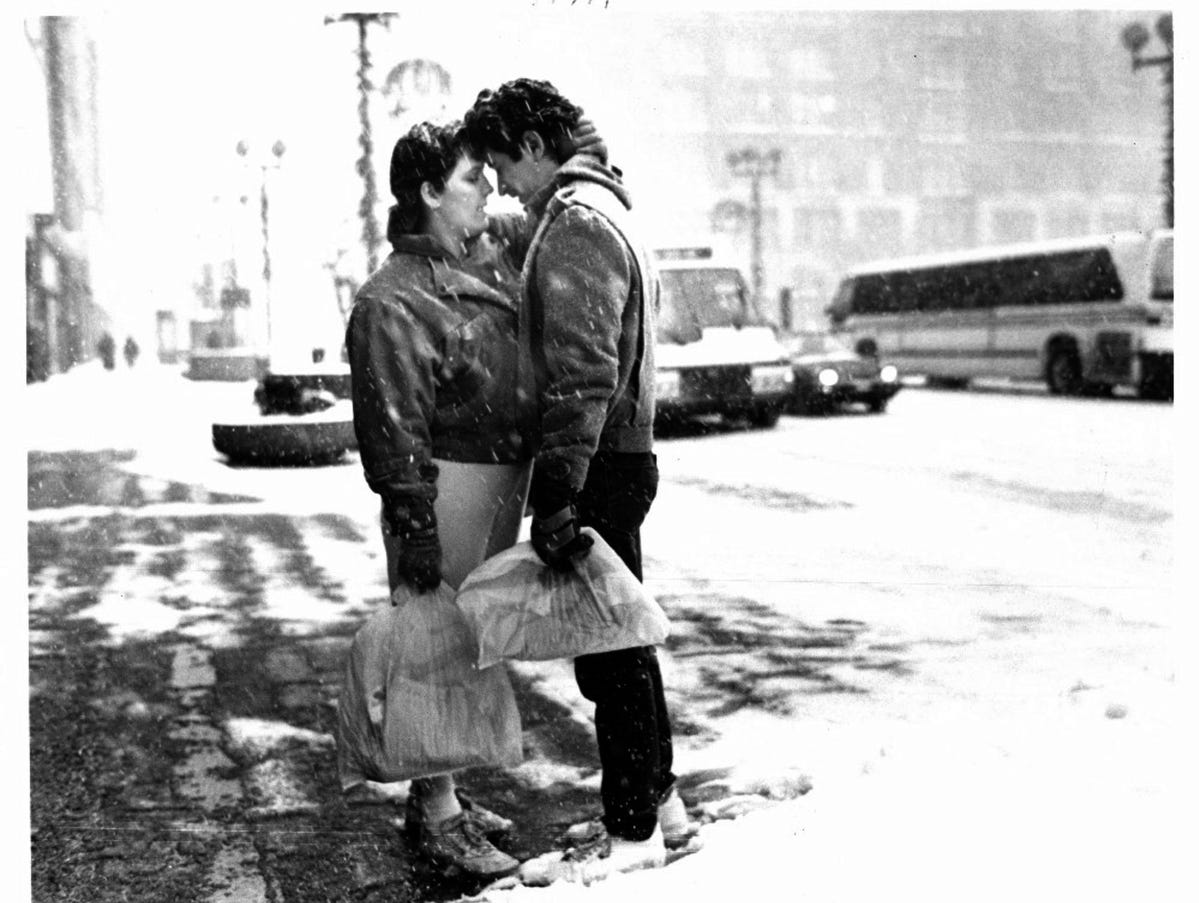 Newlyweds Renne & Don Ramirez of Detroit embrace in the snow in January, 1987.