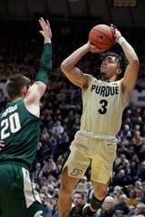 Carsen Edwards shoots over Matt McQuaid during the second half.