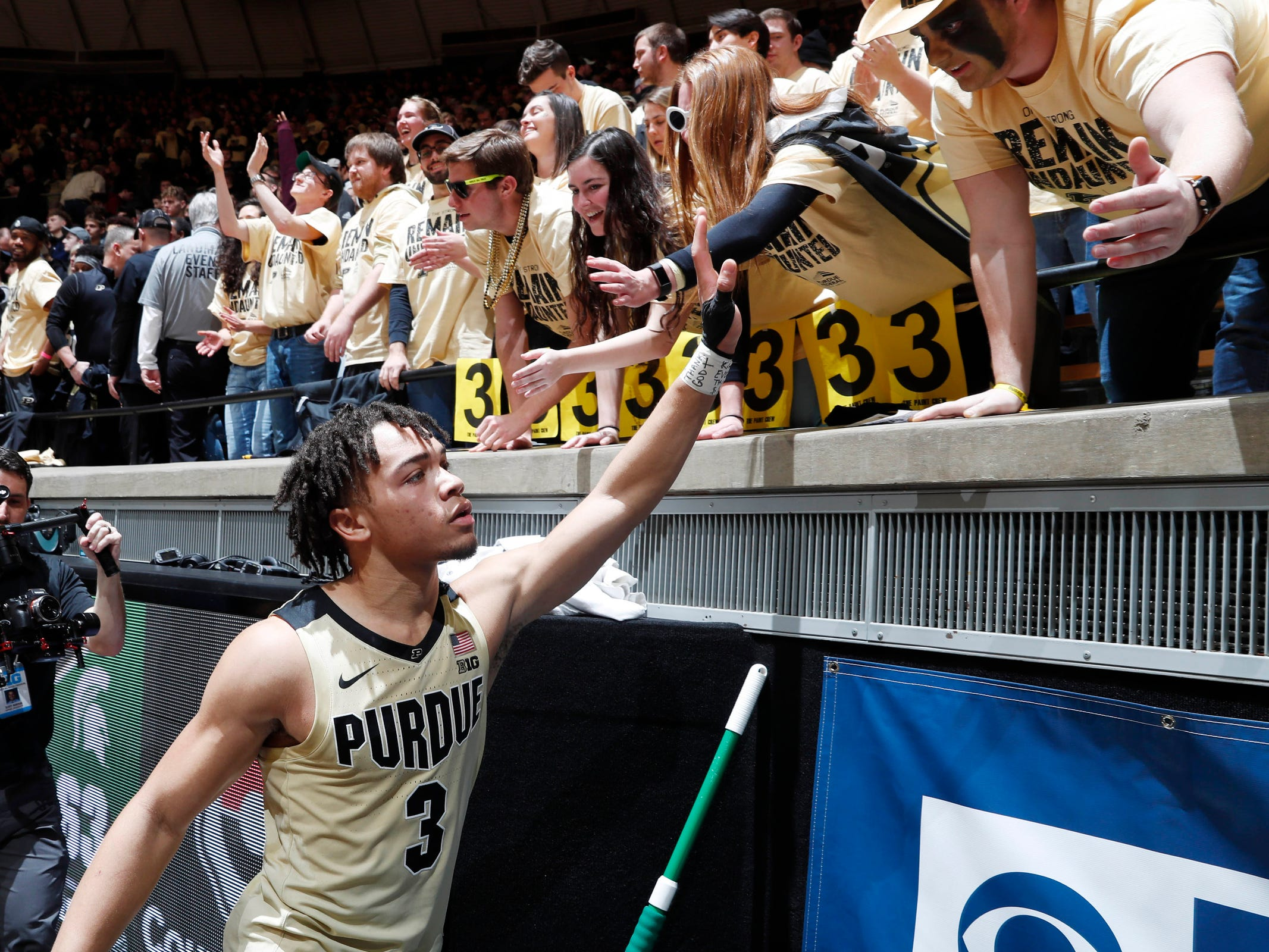 Purdue's Carsen Edwards celebrates with fans after defeating Michigan State, 73-63, at Mackey Arena in West Lafayette, Ind. on Jan. 27, 2019.