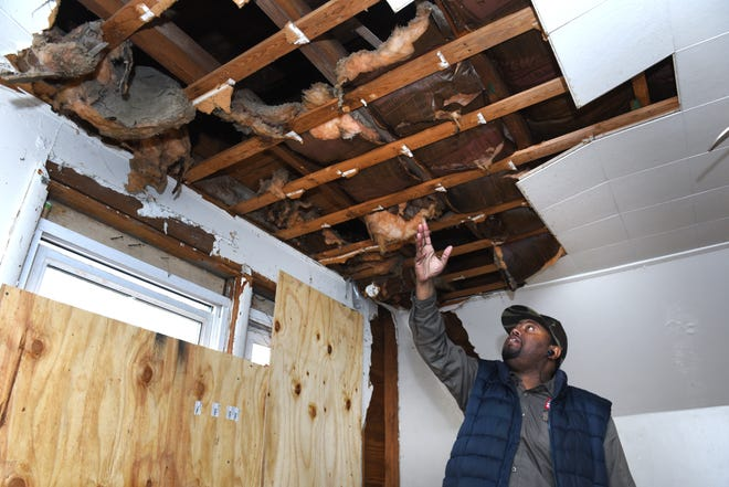 Don Garner shows some of the repairs needed at the Detroit house he purchased last year and was approved for a loan to fix  up through the Detroit 0% Interest Home Repair Loan Program.