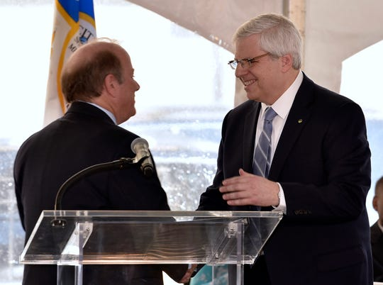 Plans announced in July by Chemical Financial Corp. Chairman Gary Torgow, right, to build a headquarters in Detroit turned out to be the first step toward a merger that will produce a $45 billion Midwest banking powerhouse. It will be based in a Motor City led by Mayor Mike Duggan, left.