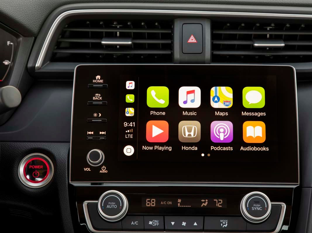 The 2019 Honda Insight comes standard with Apple CarPlay and Android Auto smartphone compatibility (shown here), adaptive cruise control and auto emergency braking for less than $24K.