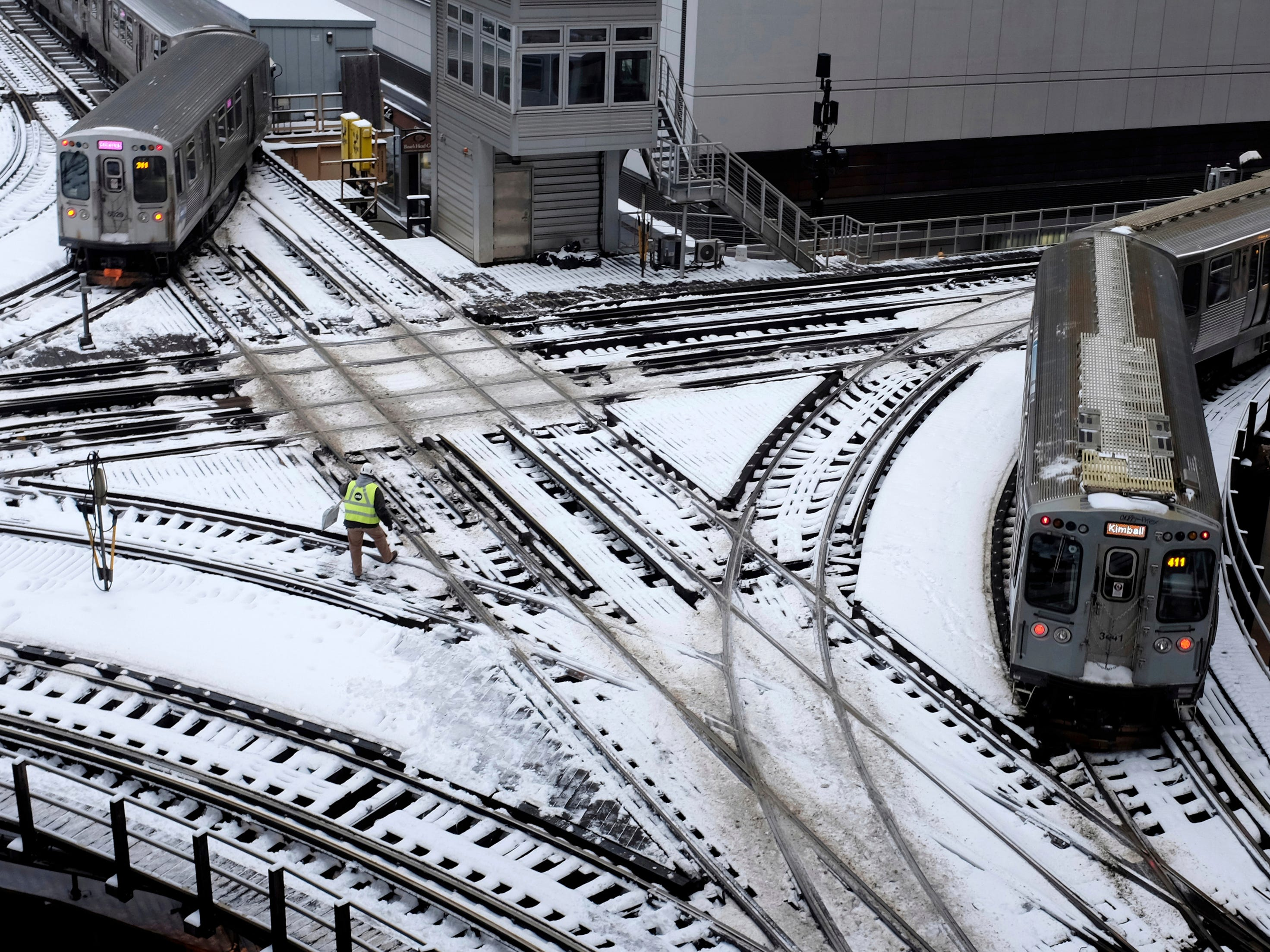 """Chicago's elevated trains move along snow-covered tracks Monday, Jan. 28, 2019, in Chicago. The plunging temperatures expected later this week have forecasters especially concerned. Wind chills could dip to negative 55 degrees in northern Illinois, which the National Weather Service calls """"possibly life threatening."""""""