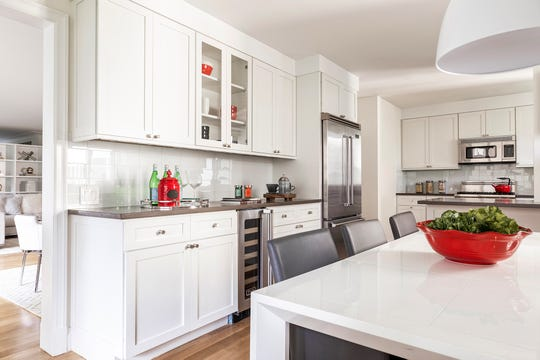 White cabinetry paired with darker countertops add both contrast and a sense of luxury. (Design Recipes)