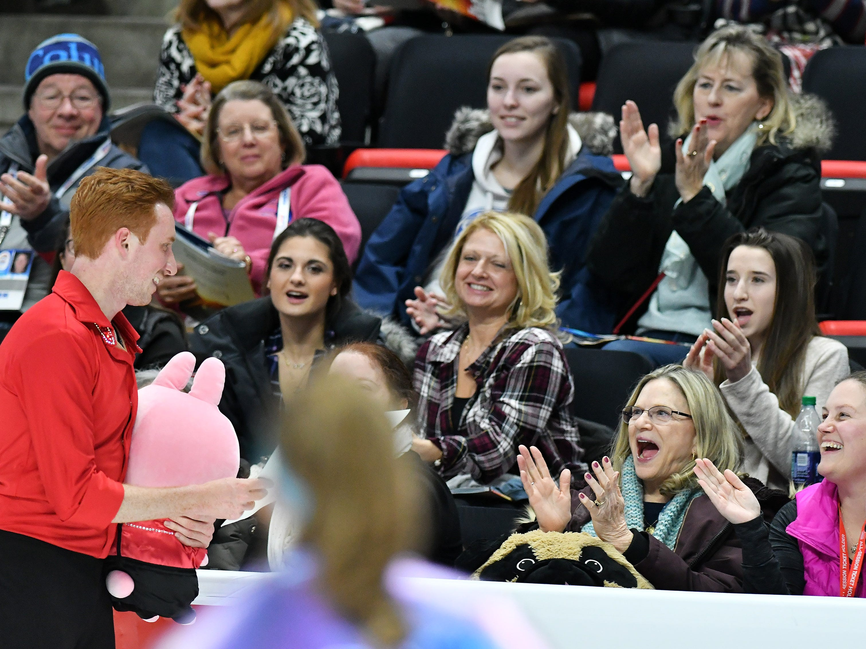 Fans cheer for Sean Rabbitt at the end of his skate in the men's free skate.