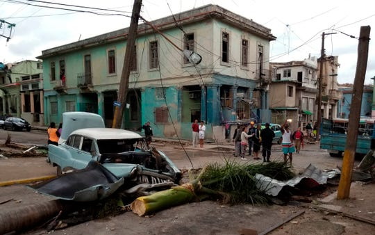 People survey the damage left behind by a tornado in Havana, Cuba, Monday, Jan. 28, 2019.