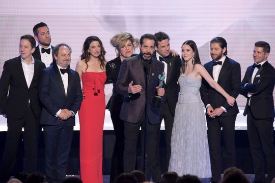 "Tony Shalhoub, center, and the cast and crew of ""The Marvelous Mrs. Maisel,"" accept the award for outstanding performance by an ensemble in a comedy series at the 25th annual Screen Actors Guild Awards."