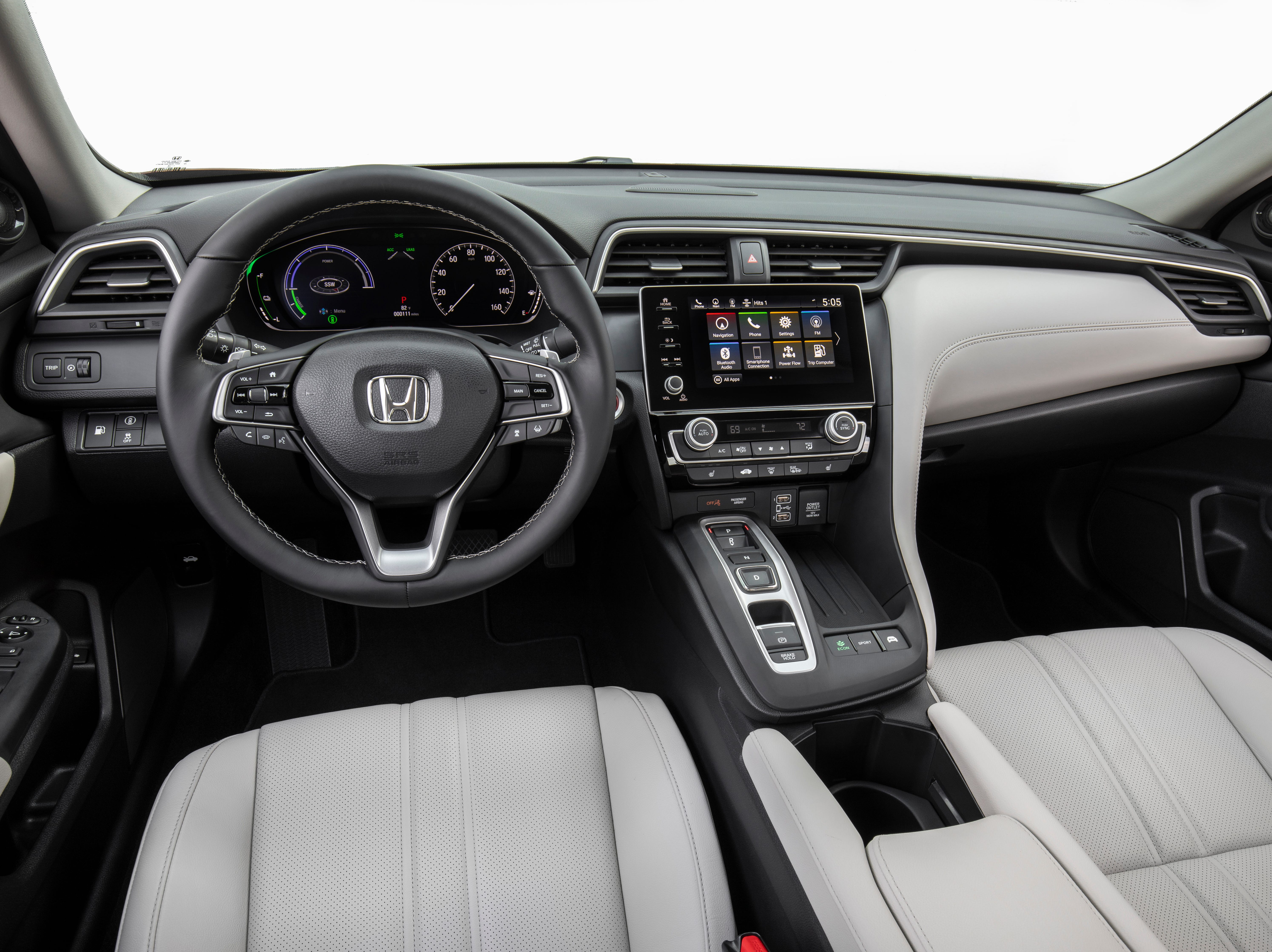 Nice digs. With its Acura-style shifter and roomy, tablet-dominated console, the 2019 Honda Insight boasts a premium vibe aimed at green customers.