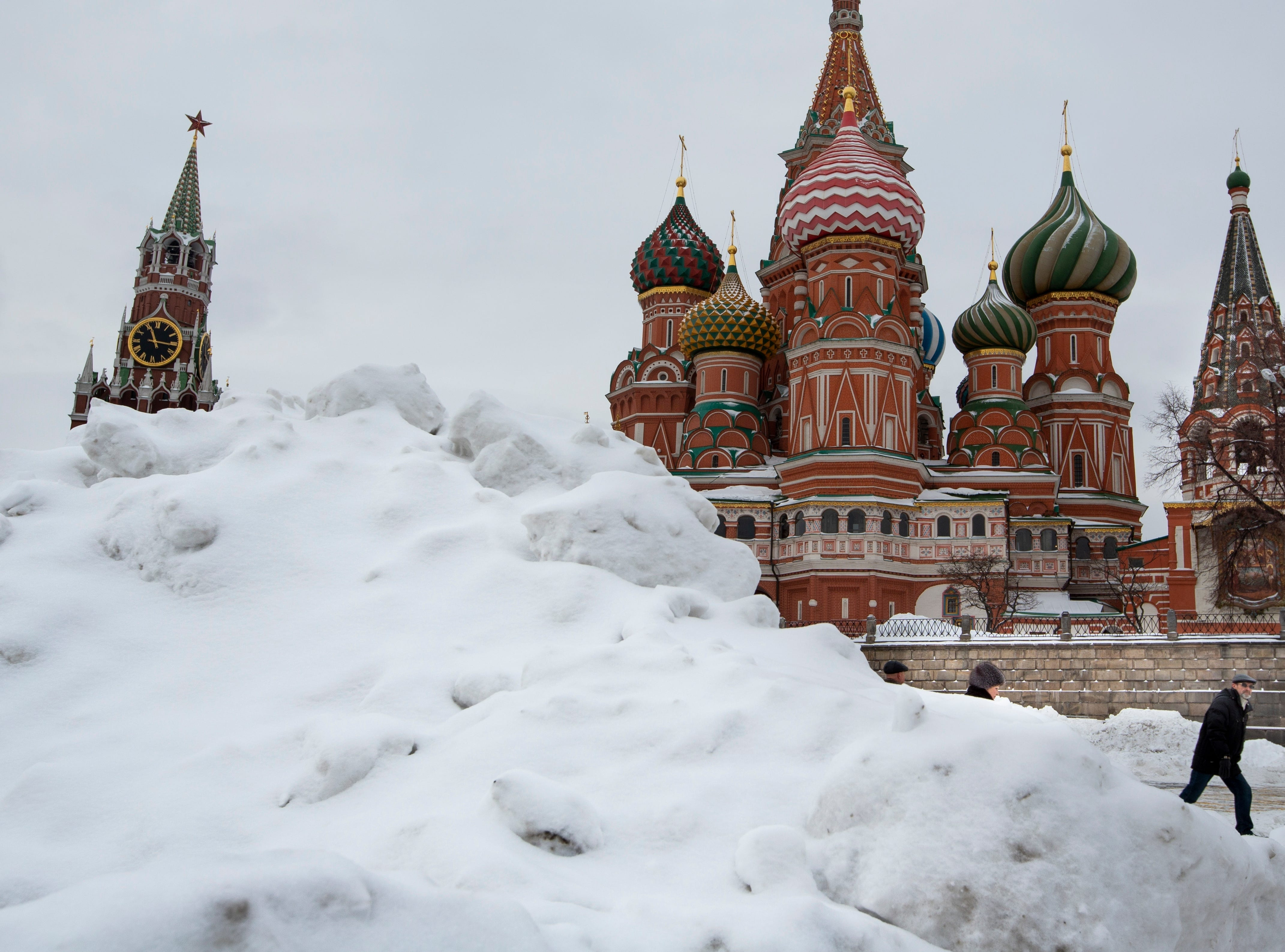 Snow covered Red Square with the Spasskaya Tower, and St. Basil's Cathedral after a snowstorm in Moscow, Russia, Monday, Jan. 28, 2019.
