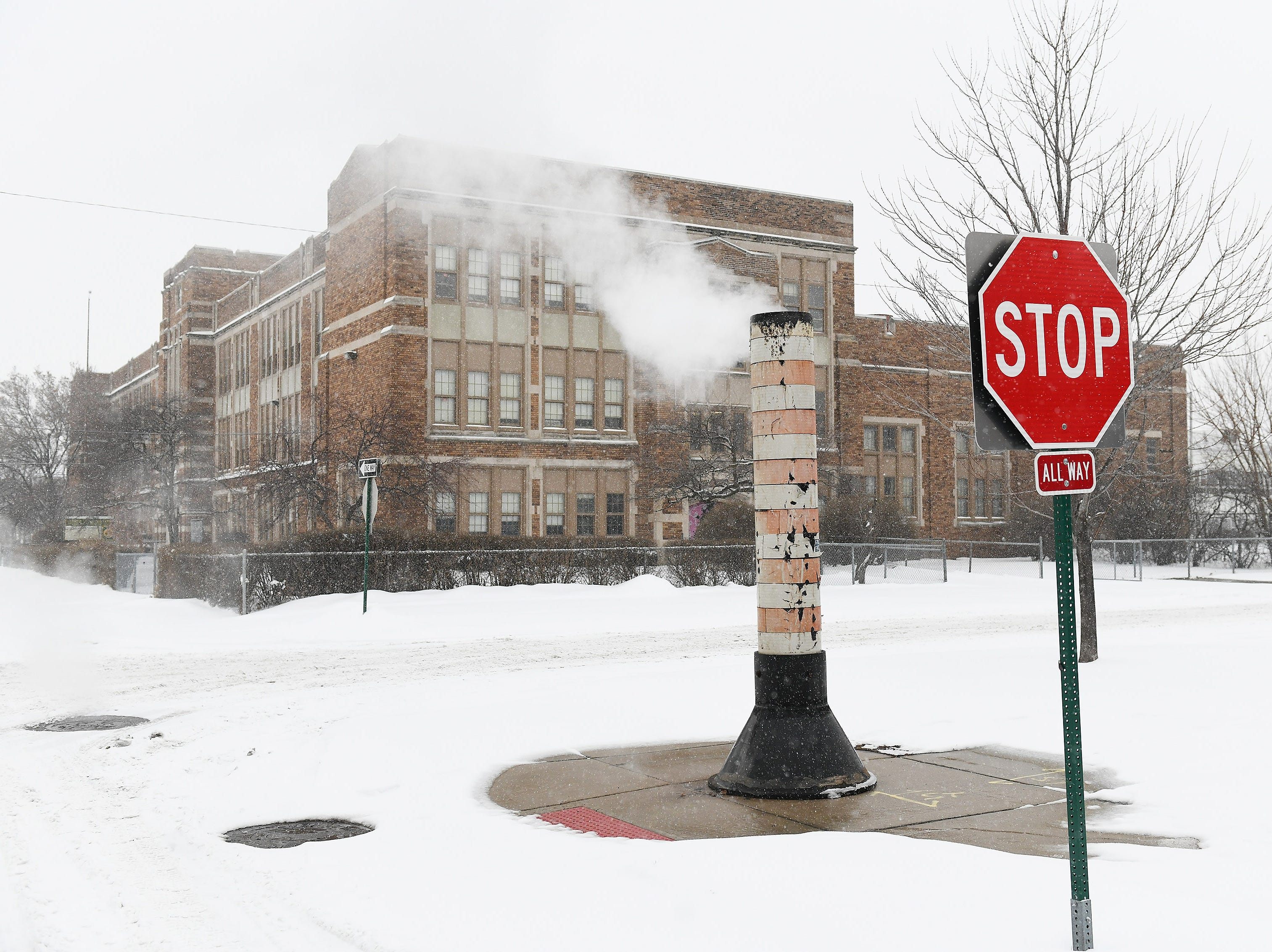 The snow melts around the steam pipe vent on a corner in Detroit on Jan. 28, 2019.