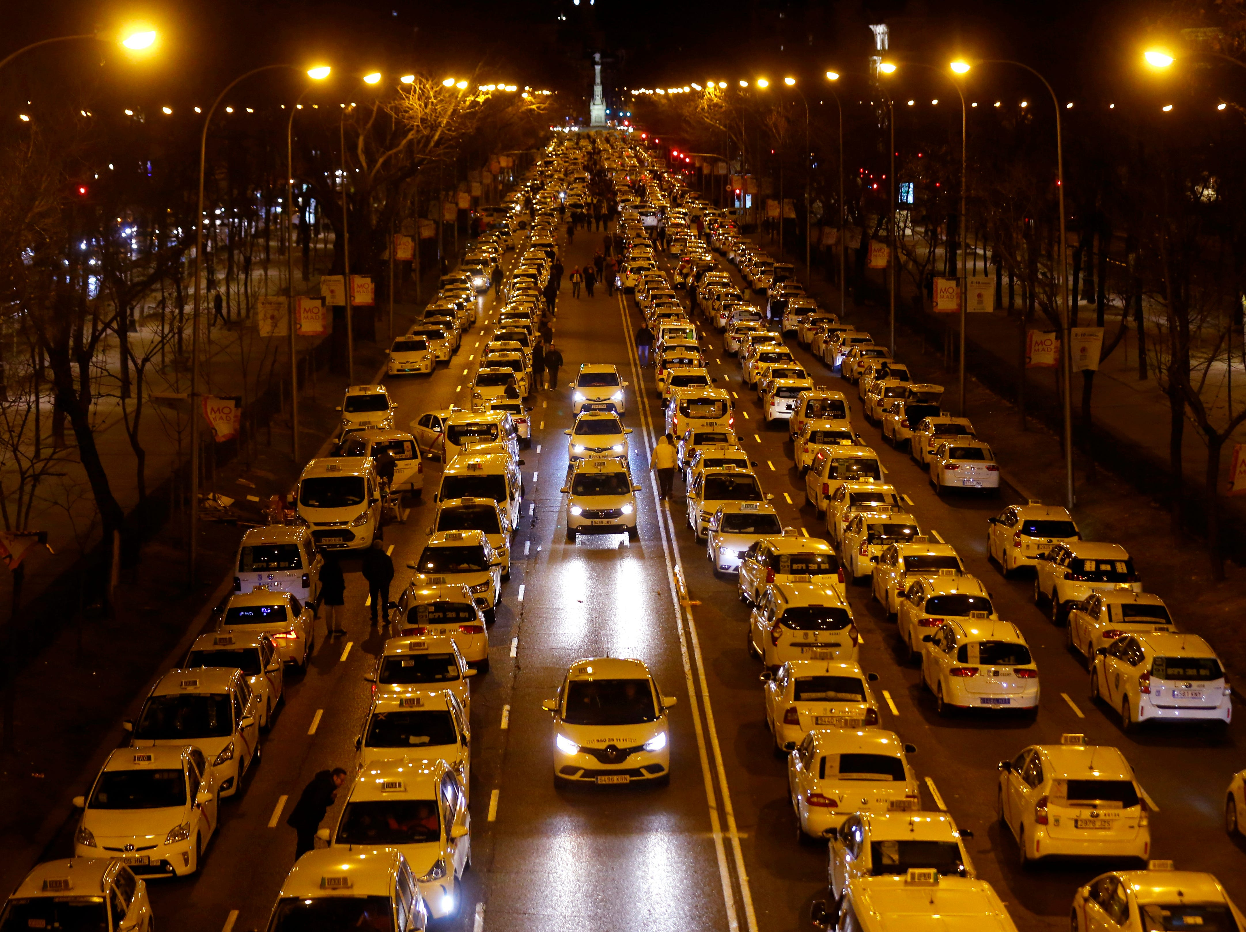 Spanish taxis block the Castellana Avenue, during a strike in Madrid, Spain, Monday, Jan. 28, 2019. The striking taxi drivers want the regional government in Madrid to impose tighter regulations for rides hailed through apps like Uber and Cabify.