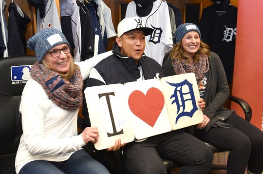Tigers slugger Miguel Cabrera poses with fans Pam Theisen, left, and her daughter Katie of Flatrock during TigerFest at Comerica Park on Saturday.