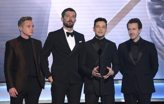 "Ben Hardy, from left, Gwilym Lee, Rami Malek and Joe Mazzello, nominated for outstanding performance by a cast in a motion picture, introduce a clip from their film ""Bohemian Rhapsody"" at the 25th annual Screen Actors Guild Awards."