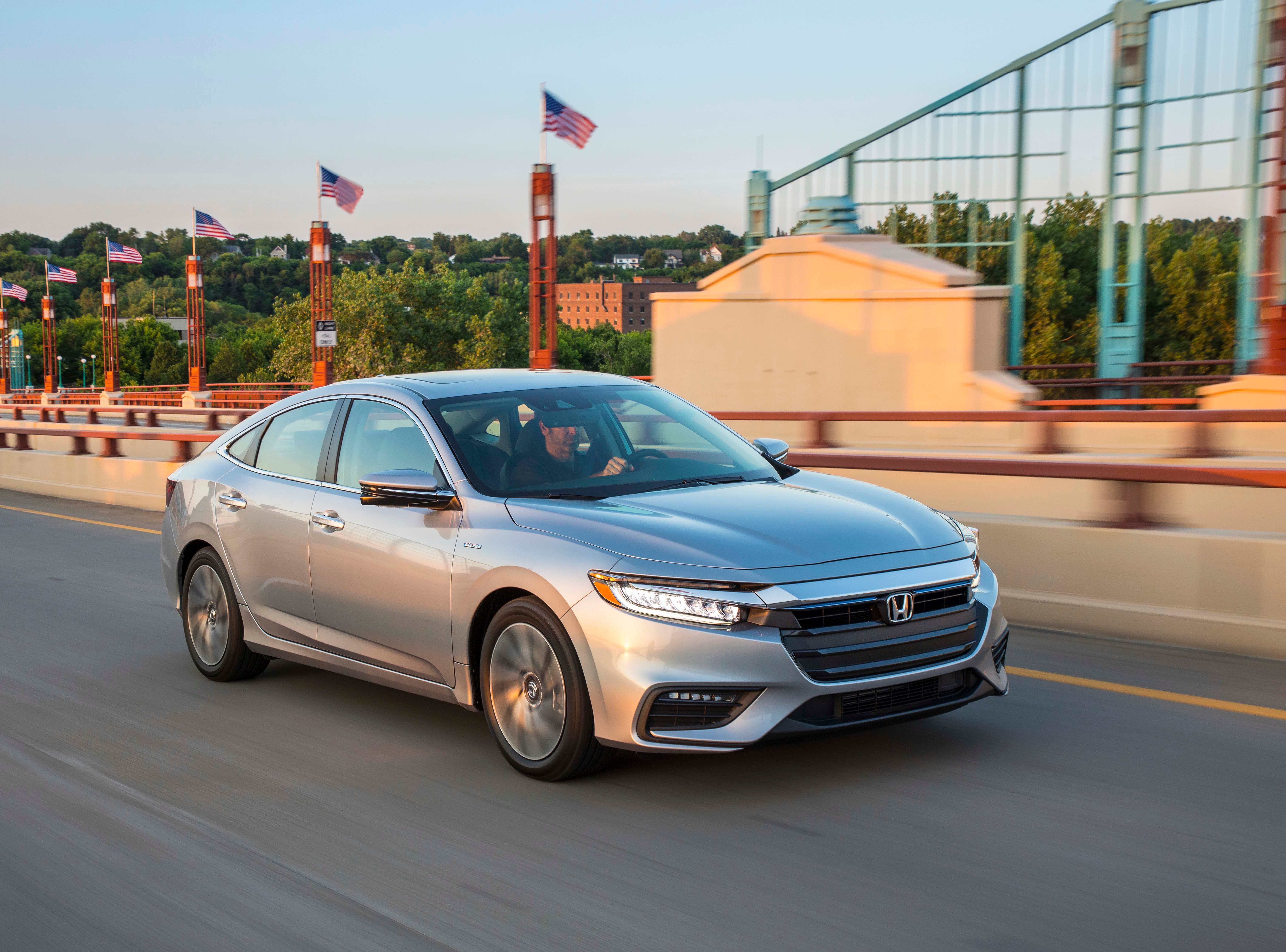 The 2019 Honda Insight sedan has ditched the rear-wheel spats and bubble shape of its predecessors for a more mature, coupe shape.