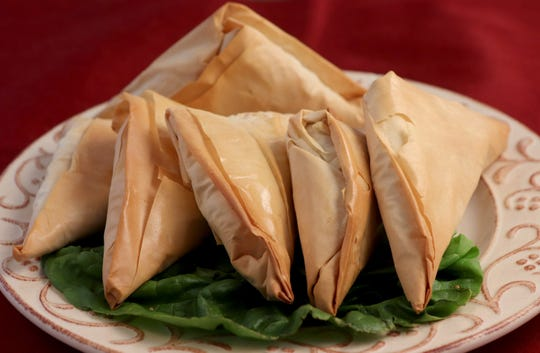 Potato and pea samosas with phyllo-wrapped dough. (Hillary Levin/St. Louis Post-Dispatch/TNS)