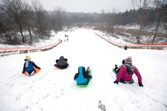 Children go sledding at Heritage Park in Farmington Hills, Monday, January 28, 2019.