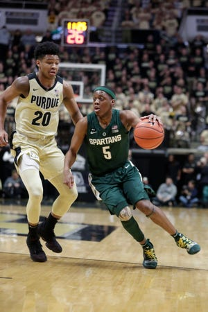 Michigan State guard Cassius Winston drives past Purdue guard Nojel Eastern during the first half Sunday.