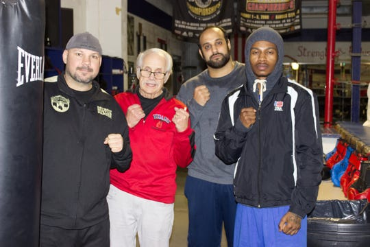 Chad Jacquillard, Metro Detroit Golden Gloves coach; joins Paul Soucy, Dynamic Boxing Club trainer; with Golden Gloves competitors Jonathan Aneed and Shontae Yelder.
