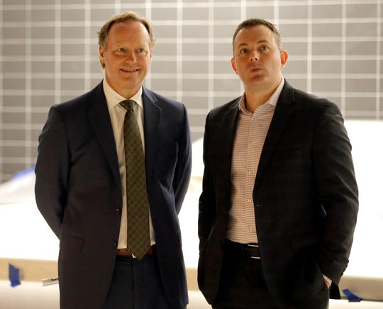 Milwaukee Bucks general manager Jon Horst, right, hired new head coach Mike Budenholzer, left, in May.