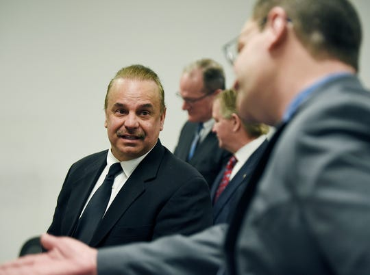Robert Carmack, left, makes a remark to Patrick McCombs, Assistant Prosecuting Attorney, Genesee County, during his pre-trial hearing Monday at 36th District Court in Detroit.