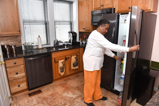 Sandra Cavette of Detroit has made various repairs and upgrades to her Detroit condo through an interest-free loan program for eligible Detroit residents.