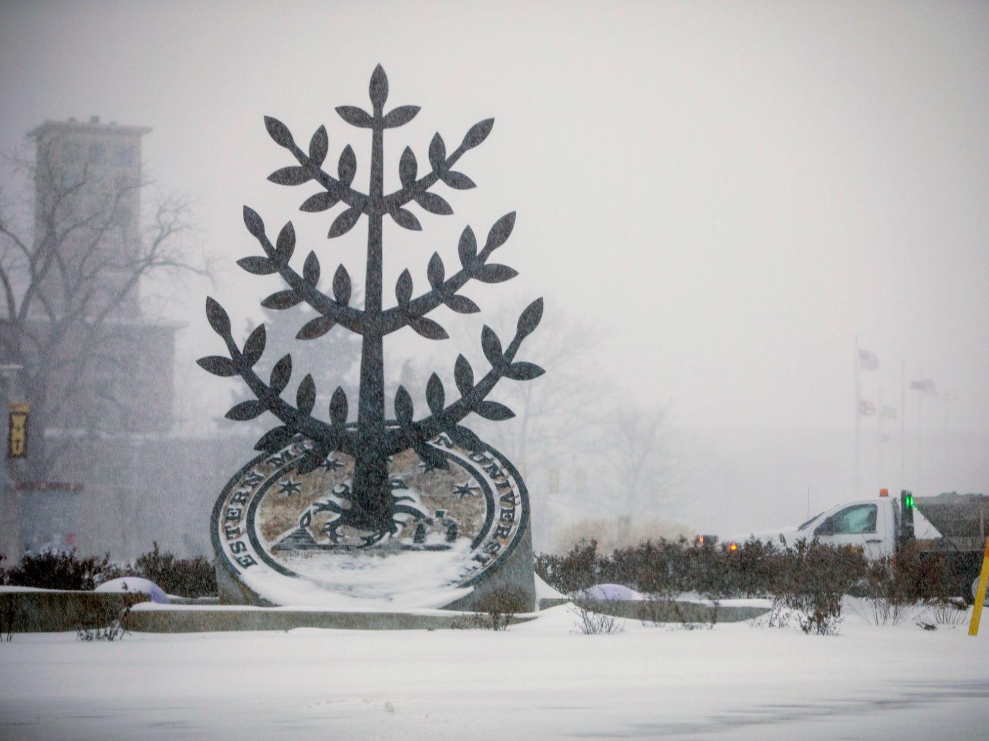 Snow falls on the campus of Western Michigan University in Kalamazoo, Monday.