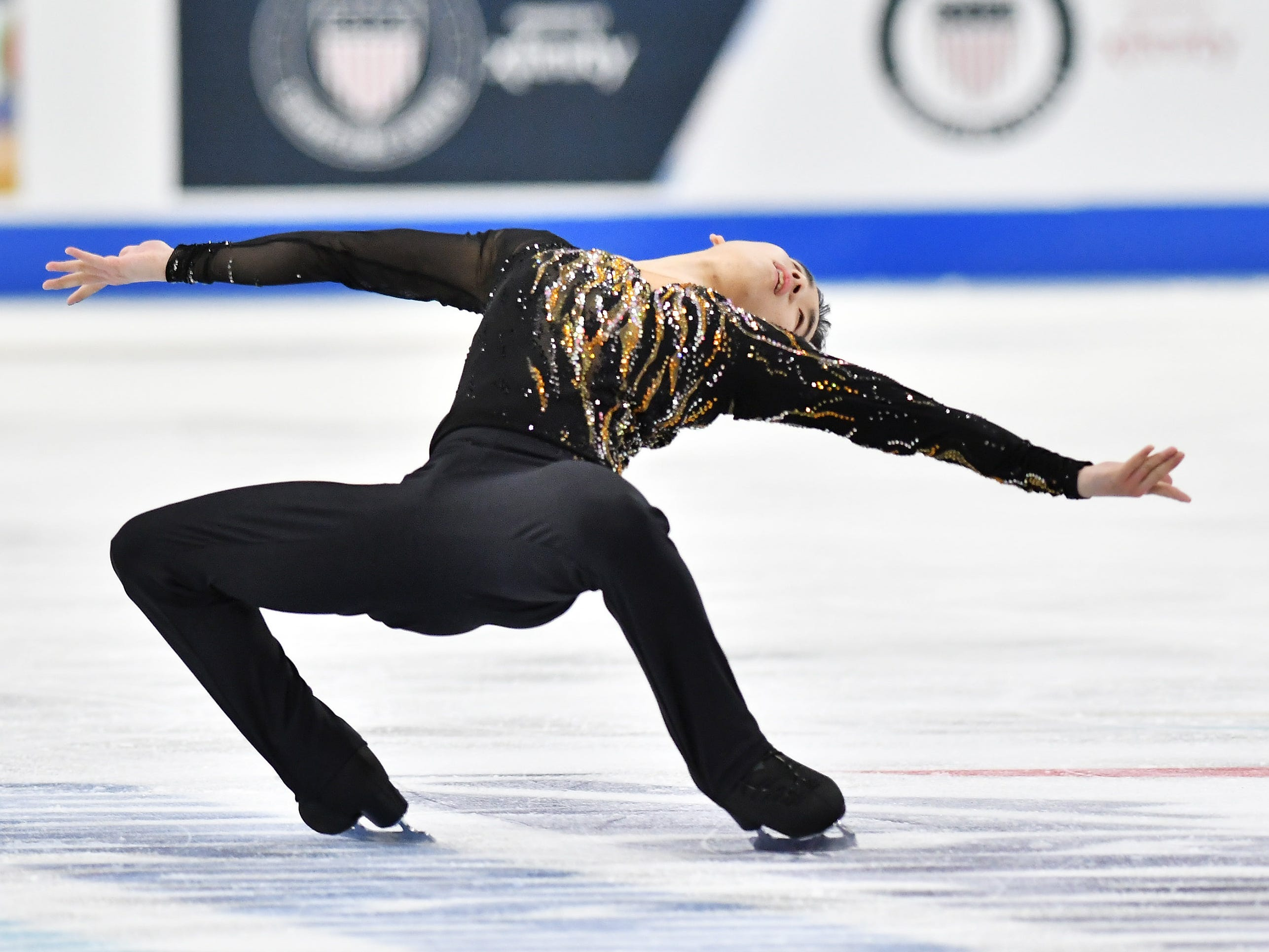 Tomoki Hiwatashi skates in the men's free skate.