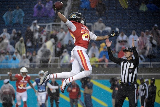 Jalen Ramsey of the Jacksonville Jaguars, dunks the football after scoring against the NFC during the second half of the  Pro Bowl on Sunday.