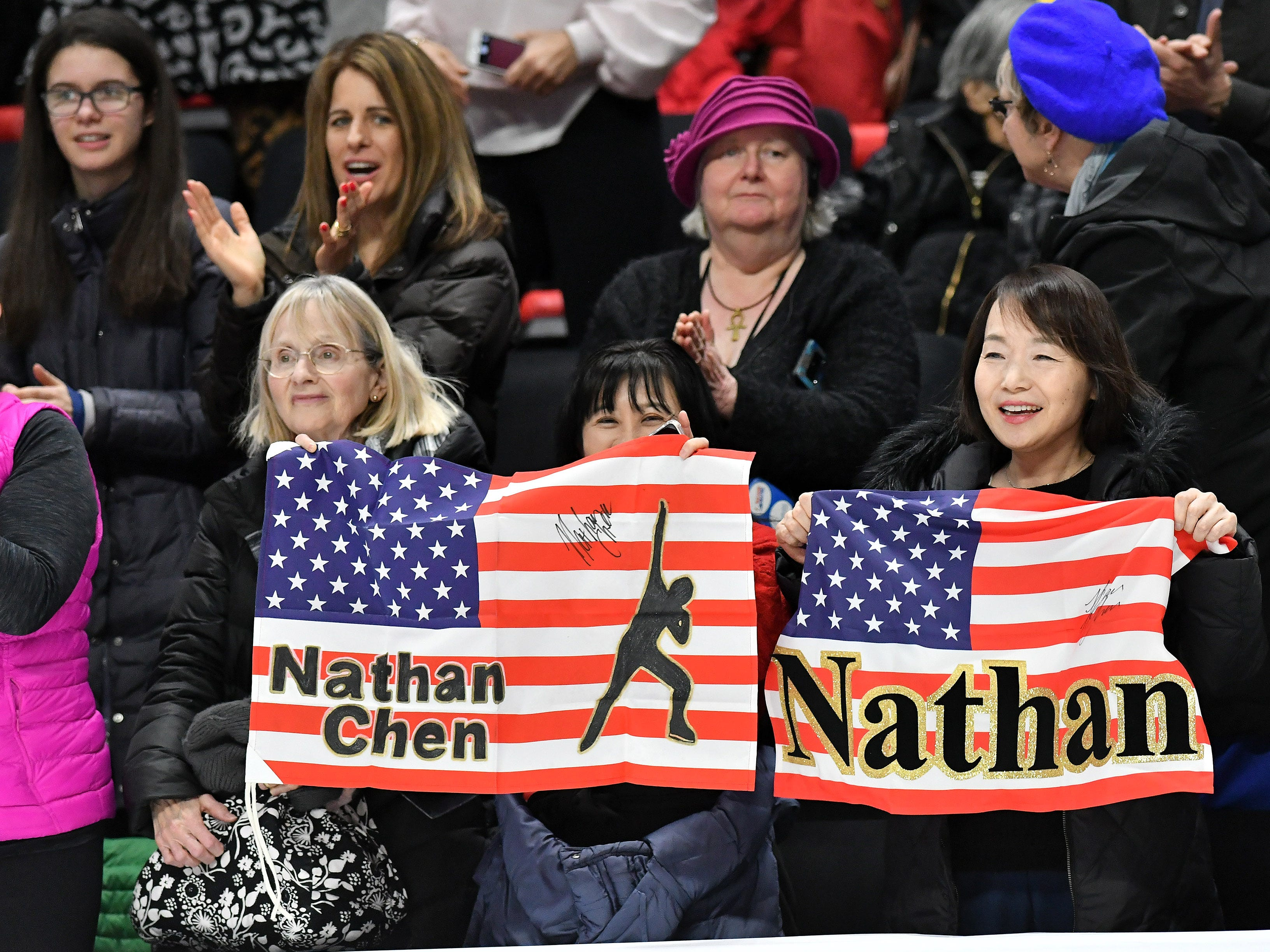 Fans cheer after Nathan Chen skates in the men's free skate.