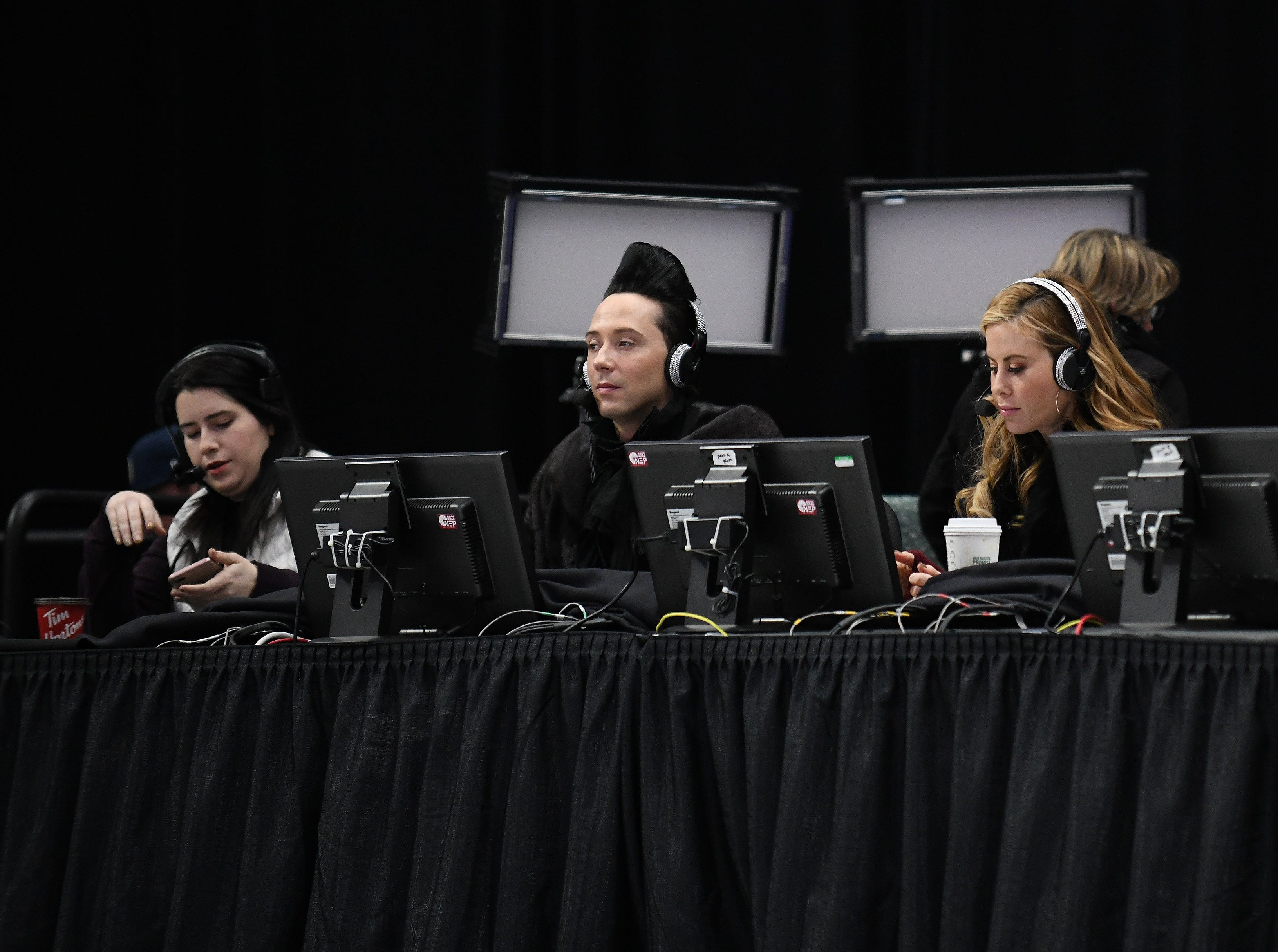 Tara Lipinski, right, and Johnny Weir, center, give the commentary in the men's free skate competition.