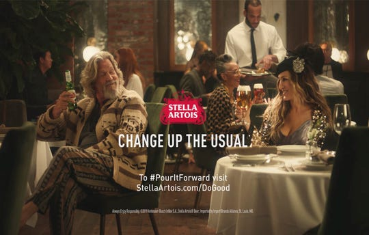 A scene from Stella Artois' Super Bowl spot with Sarah Jessica Parker, right, and Jeff Bridges.