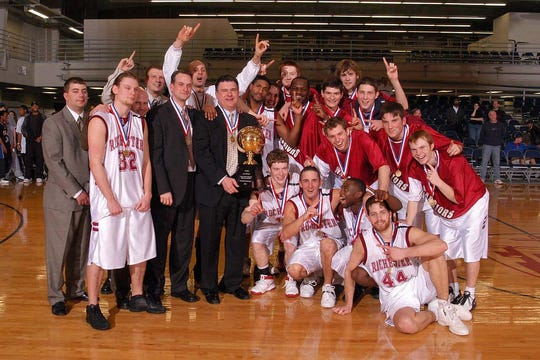 Jon Horst (middle, in warm-up jersey) helped Rochester College win United States Collegiate Athletic Association Division 1 national titles in 2003-04 and 2004-05.