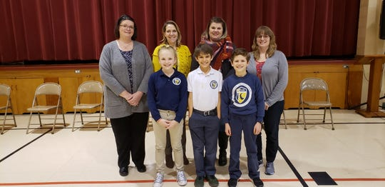 Immaculate Conception School named its spelling bee winners. Student winners are pictured with teacher Theresa Radcisk and judges in back.