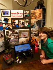 """10-year-old Hayden Fuller and his invention, """"Hayden Life Pods."""""""