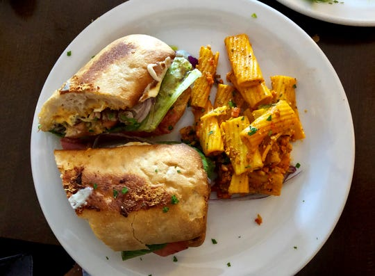 The lunch menu at La Trattoria Cafe Napoli features panini stuffed with roasted vegetables, prosciutto, roasted pork and more.
