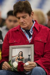 Karl Beckerich attends a vigil on Sunday at the News-Sun Center in Sebring, Florida, for his friend, Jessica Montague, pictured, and four other people that were killed in a shooting at a SunTrust Bank on Jan. 23 in Sebring. Hundreds of Sebring community members attended the service.