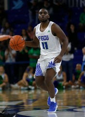 Florida Gulf Coast University's Schardrac Casimir moves the ball up court during their game against the University of North Florida at Alico Arena earlier this season.