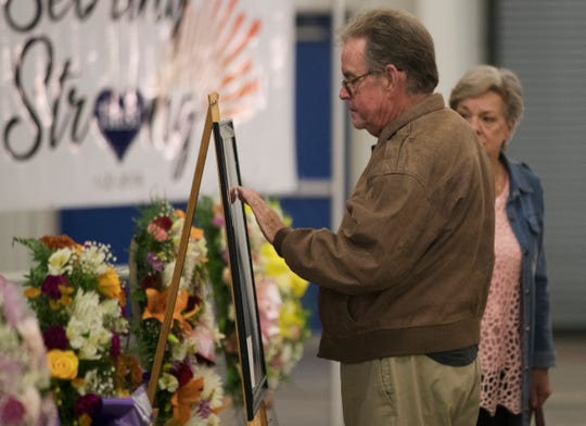 Tom Herbert attends a vigil on Sunday, Jan. 27, 2019, at the News-Sun Center in Sebring, Florida, for five people killed in a shooting at a SunTrust Bank on Jan. 23 in Sebring. Hundreds of Sebring community members attended the service.