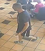 A suspect in the beating of a 68-year-old man in the restroom of a North Fort Myers fast food restaurant was caught on a surveillance camera.