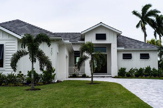 The 2018 house in the Orchid Neighborhood of Cape Coral was designed and conceptualized by Tia and her husband Anthony Faraht of PGI Home. The house is 4,000 sq/ft with four bedrooms, three full baths, an office and a riverview patio. The theme of the house resembles the traditional aspects of a yacht. Hence, it is called the Yacht Man.