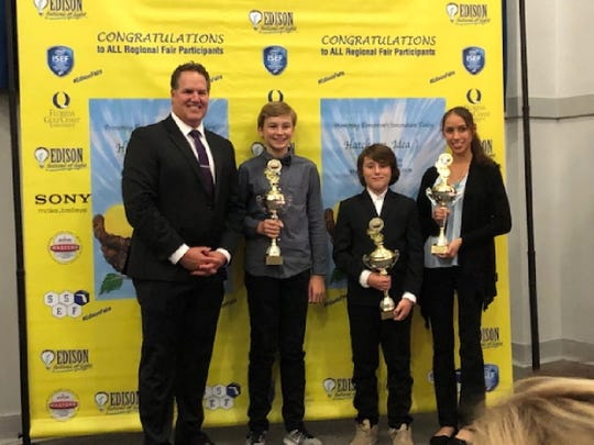 Thomas Alva Edison Regional Inventors Fair winners attended an awards celebration on Jan. 23. During this ceremony,  the top three were presented awards by NBC@ co-anchor Clay Miller. Pictured with him are Middle school division winner, Robert Stewart, a seventh-grader at Paul Laurence Dunbar Middle School; Elementary division winner Hayden Fuller, a fourth-grader at Rayma C. Page Elementary School; and High school division winner Arianna Carrillo, a ninth-grader at Bonita Springs High School.