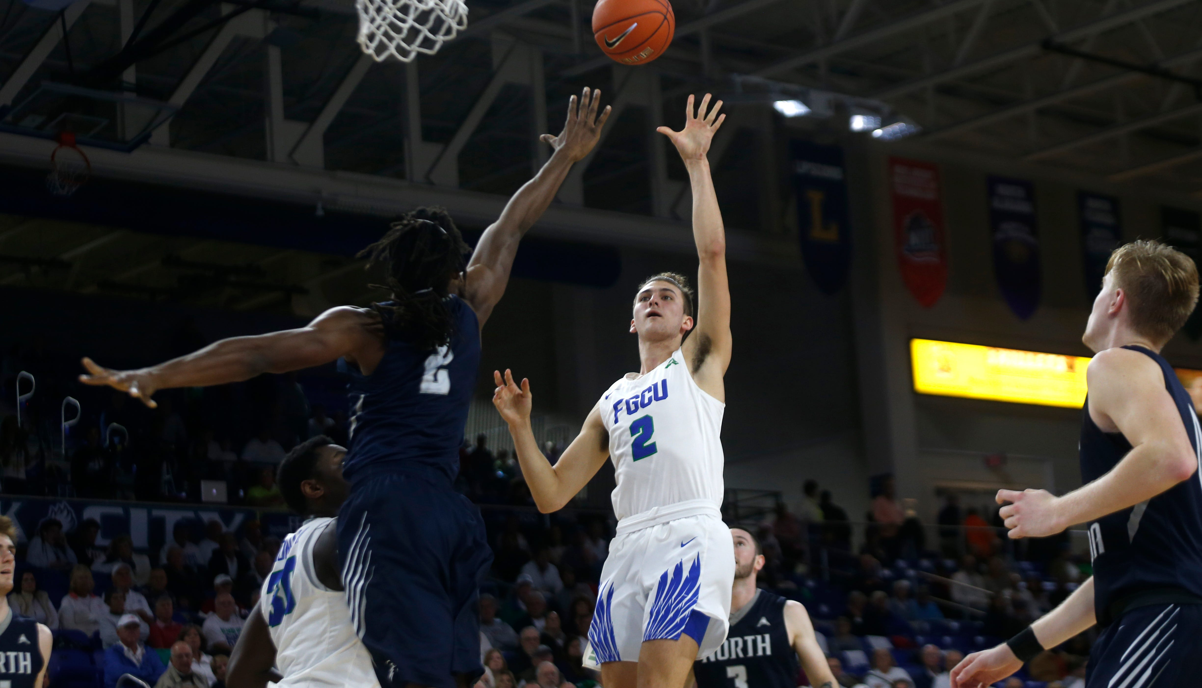 Florida Gulf Coast University's Caleb Catto shoot the ball over the University of North Florida's Wajid Aminu, Saturday, Jan. 27, 2019, at Alico Arena in Fort Myers.