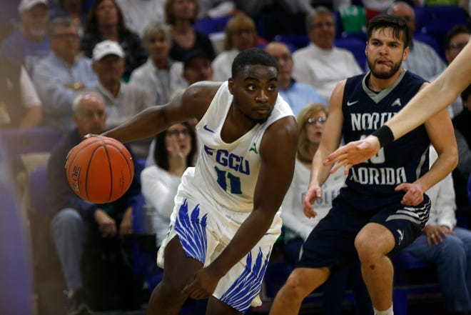 Florida Gulf Coast University's Schadrac Casimir dribbles the ball toward the basket during their game against the University of North Florida, Saturday, Jan. 27, 2019, at Alico Arena in Fort Myers.