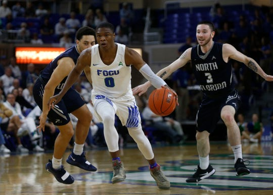 Florida Gulf Coast University's Decade Day dribbles the ball during their game against the University of North Florida, Saturday, Jan. 27, 2019, at Alico Arena in Fort Myers.