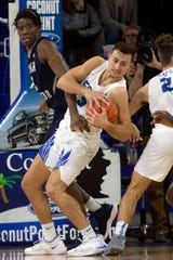 Florida Gulf Coast University's Christian Caryle pulls down the rebound against the University of North Florida, Saturday, Jan. 27, 2019, at Alico Arena in Fort Myers.